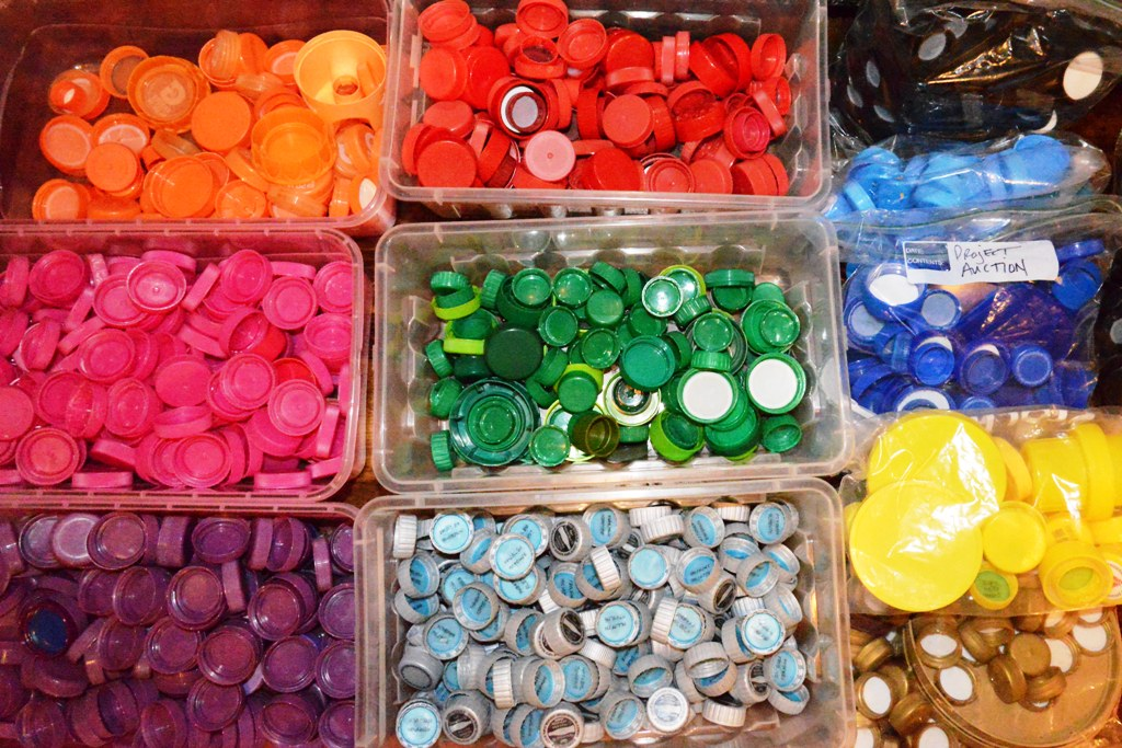 Plastic Bottle Caps in Shoe Boxes