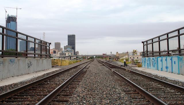 Graffit on a train track against the Oklahoma skyline