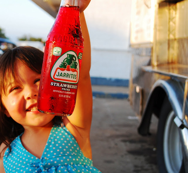 Little girl and Jarritos