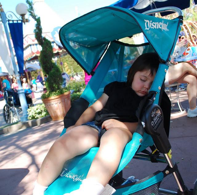 Little girl in a Disneyland Stroller