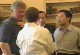 John Huang (center) with Bill Clinton, James Riady (right), and Clinton aide Mark Middleton (with back to camera) in the Oval Office