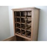 Pine wine rack with cupboard. W43cm.