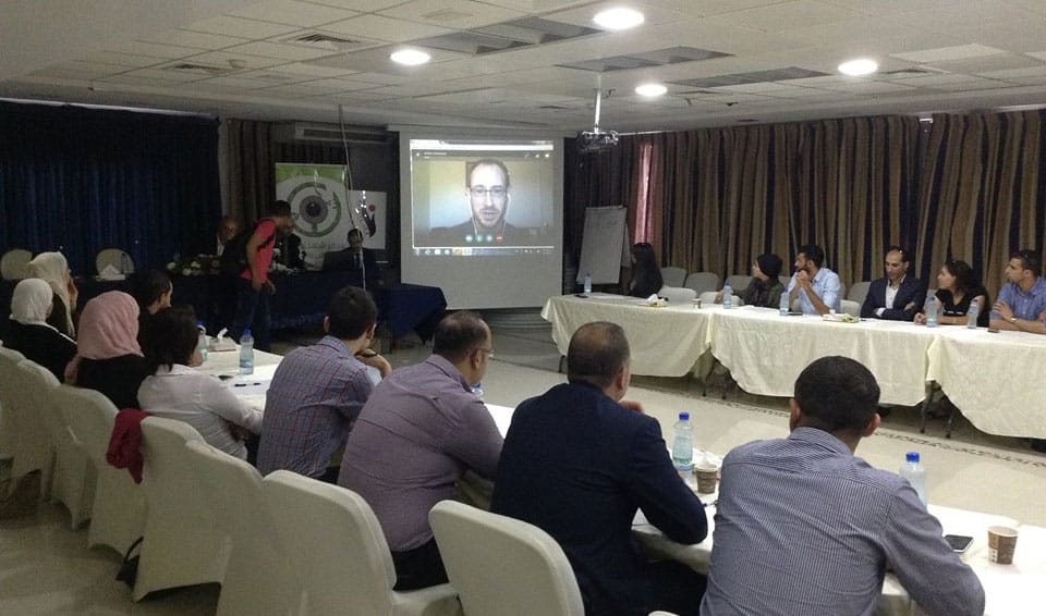 "Jeremy R. Hammond speaks via Skype on the role of the US media in the Palestine conflict at the second of a series of conferences titled ""100 Global Thinkers in Palestine"". Ramallah, September 20, 2016. (Photo: SHAHED)"