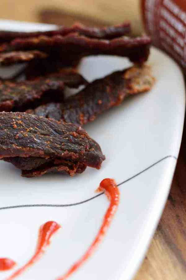 A sriracha beef jerky that doesn't over power you with spice, but rather blends in with the other flavors making a perfect jerky | Jerkyholic.com