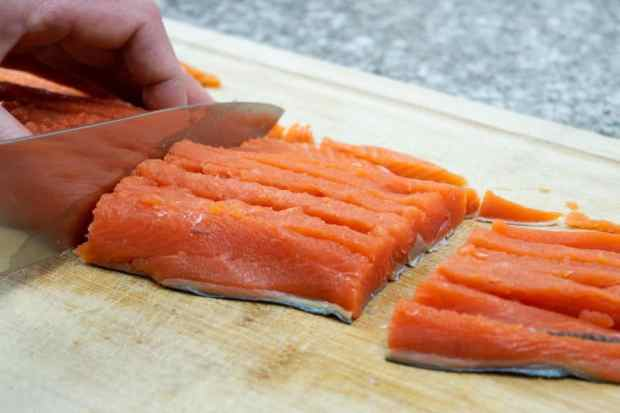 Wild sockeye salmon filet cut in small strips for jerky