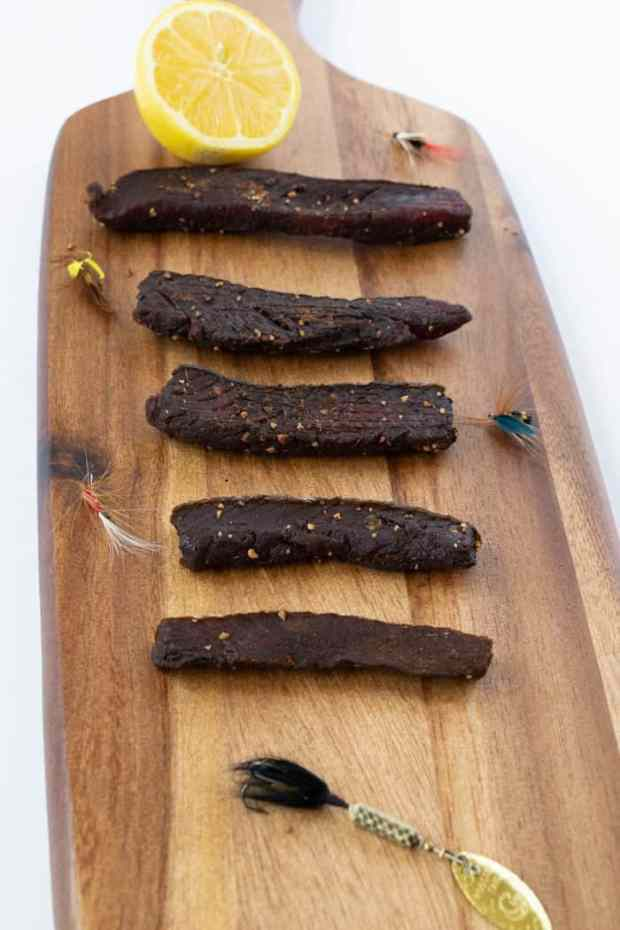 Salmon jerky on a cutting board