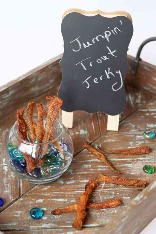 Fish jerky on tray with sign