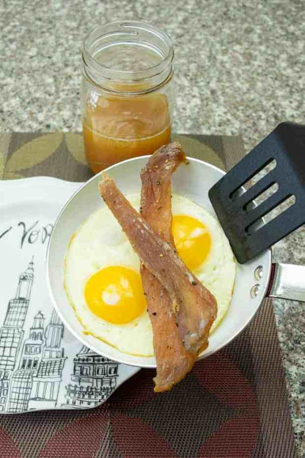 apple sage jerky on frying pan with eggs and apple juice