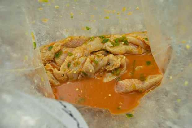 Turkey marinating in peruvian jerky seasoning