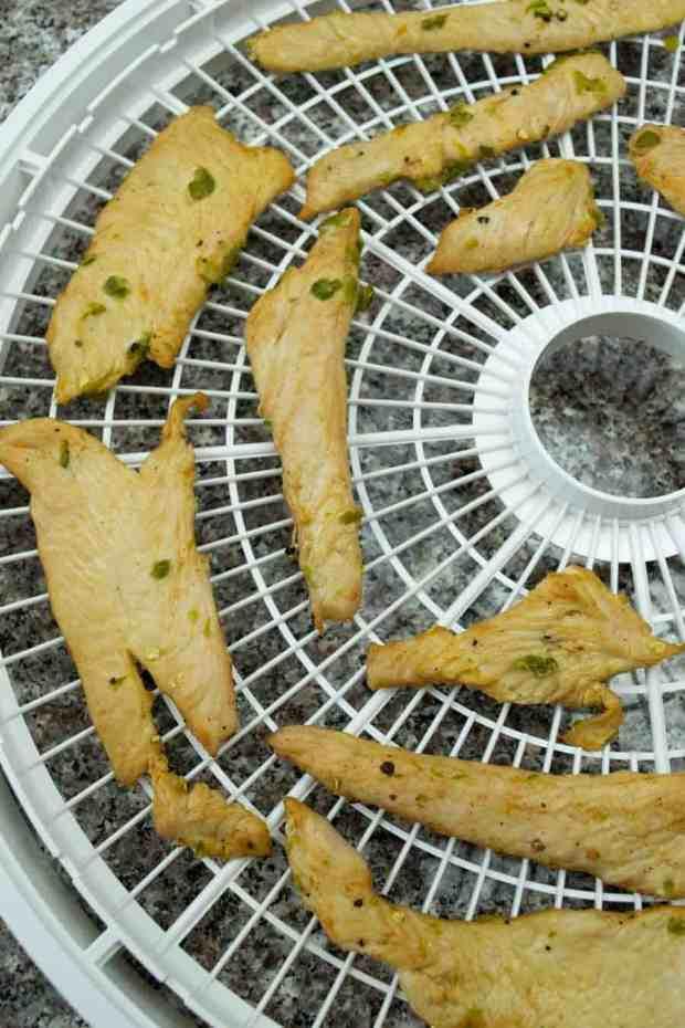turkey jerky on dehydrator trays ready to dry