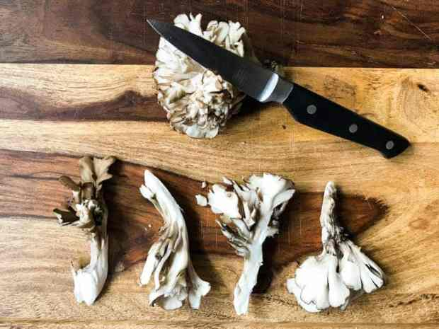 Sliced Maitake Mushrooms, knife and cutting board