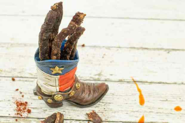 Beef jerky in cowboy boot painted with texas flag