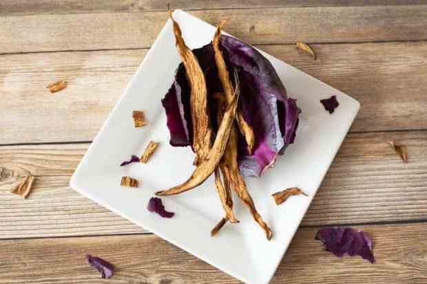 Eggplant jerky on red cabbage on white plate