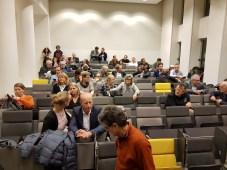 Docenten en medewerkers van de Hogeschool van Amsterdam wachten het oordeel van het panel af.