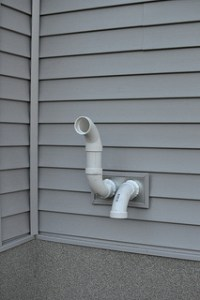 Should a Gas Furnace Flue Pipe Go Through the Roof or the