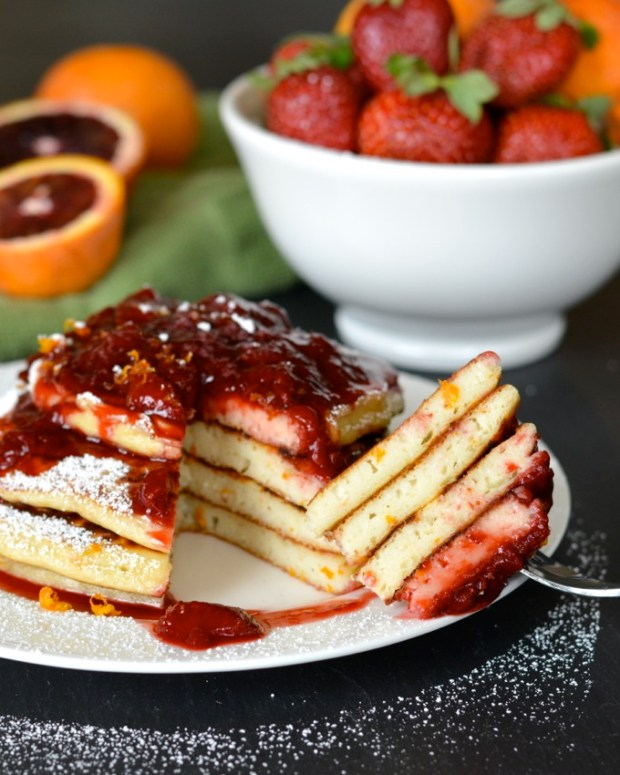 These Blood Orange Ricotta Pancakes are silky, creamy and studded with bright orange zest. They're topped with a fresh strawberry and blood orange sauce. A perfect weekend breakfast!
