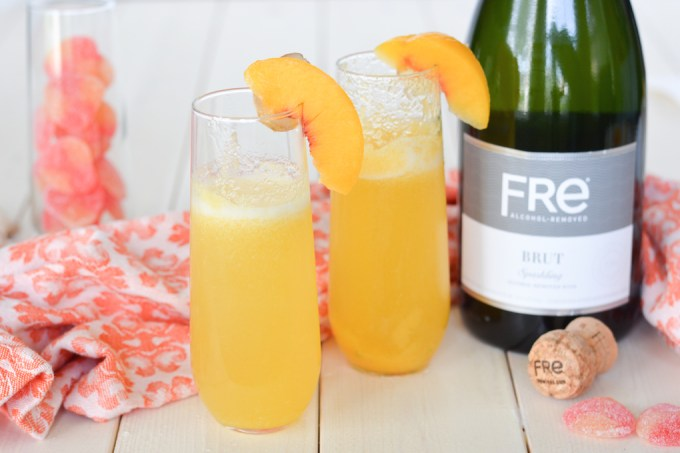 These Ginger Peach Bellini Mocktails are great for pregnant ladies or anyone else avoiding alcohol. The combination of sweet peaches, spicy ginger and a little bubbly is perfect for any celebration!