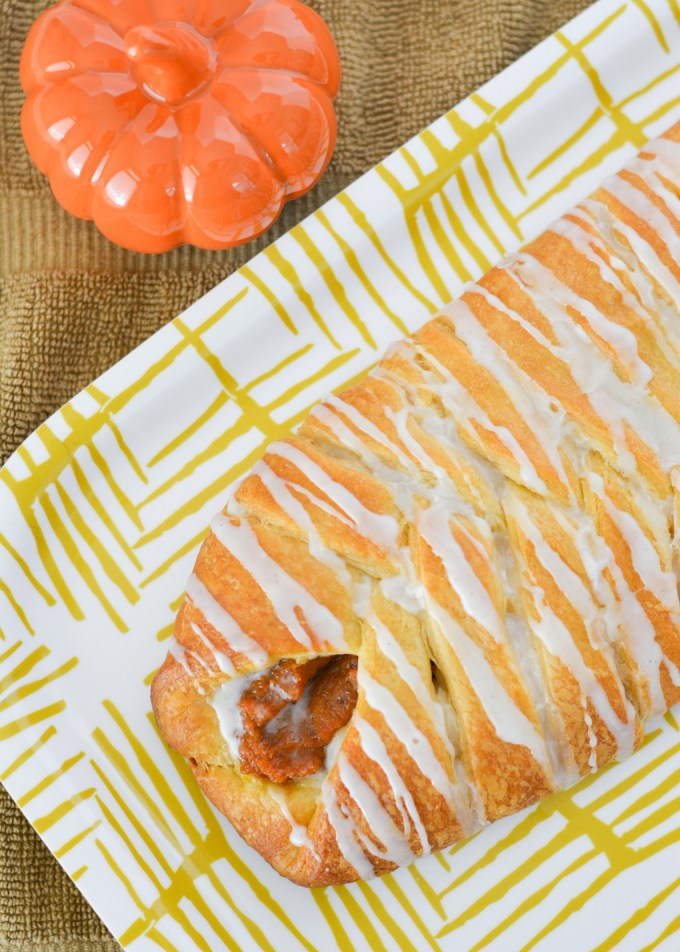 This Pumpkin Cheese Danish Braid is easy but impressive, and perfect for your fall brunch! Crescent roll dough stuffed with spiced pumpkin and sweetened cream cheese bakes up perfectly and so prettily!