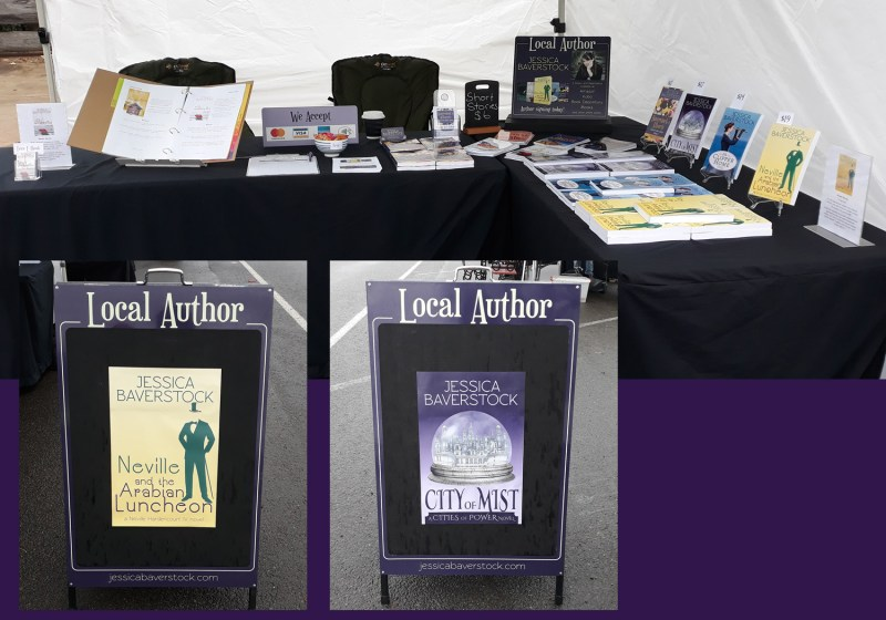 My market stall setup with two tables and an a-frame sign.