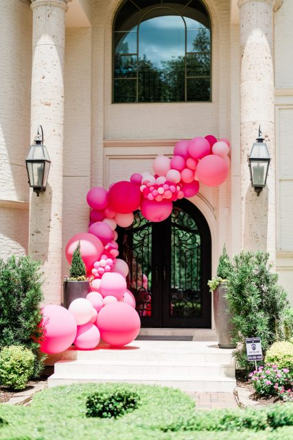 Cute Pink Baby Shower Ideas featured by top Houston lifestyle blogger and expecting mom, Jessica Crum.   Pink Baby Shower by popular Houston motherhood blogger, Jessica Crum: image of a Lushra pink balloon garland.