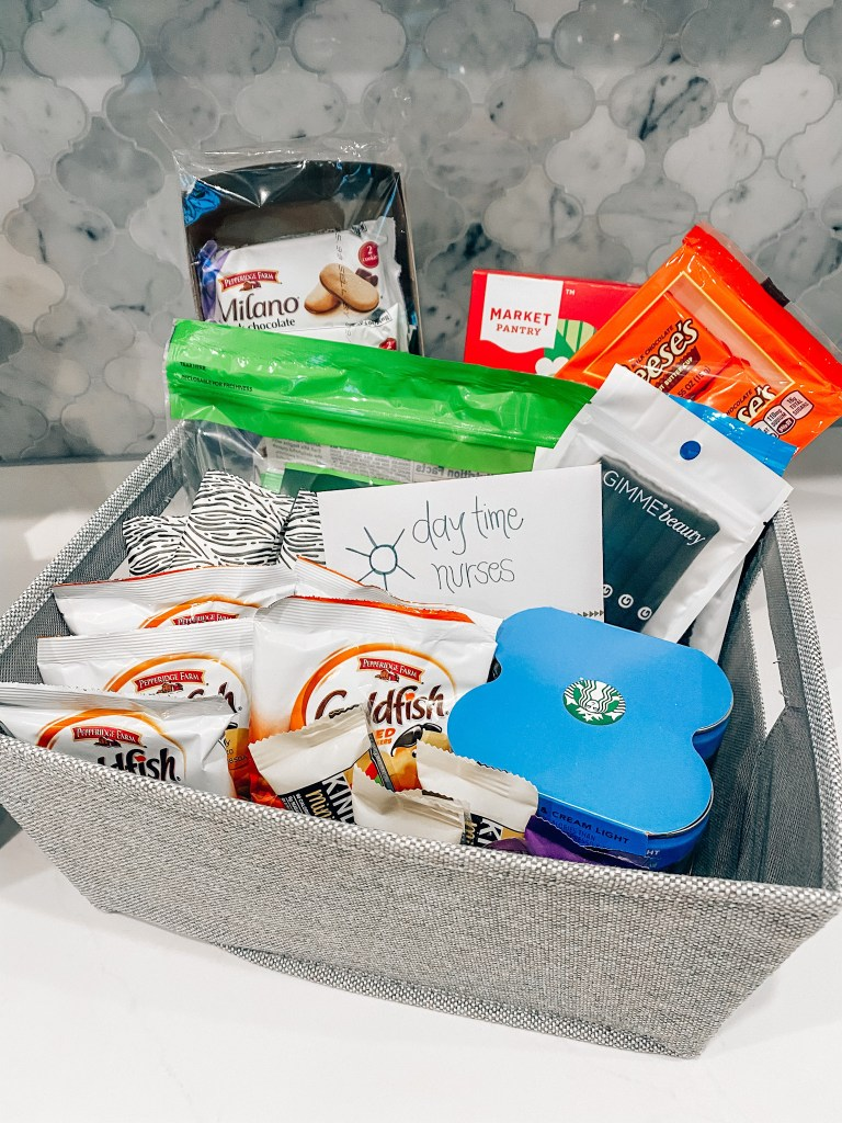 Hospital Bag by popular Houston motherhood blogger, Jessica Crum: image of a grey bin containing Goldfish crackers, Reese's Peanut Butter Cups, Starbuck's, and Milano Cookies.