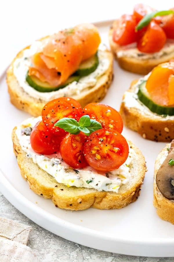 crostini on a platter with various toppings