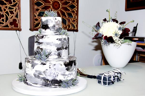 Fancy black and grey with silver leaf wedding cake.