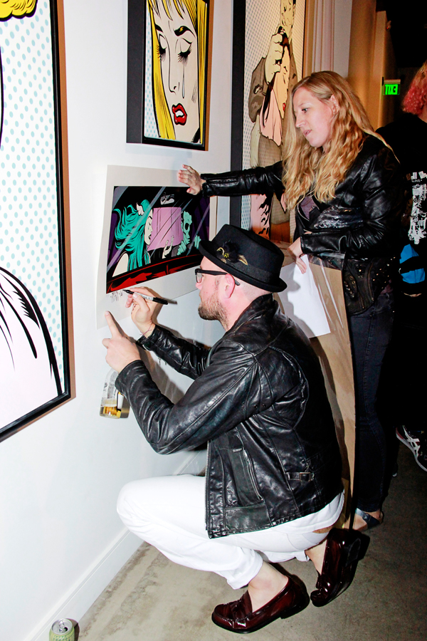 Dface signing print at his opening Corey Helford Gallery