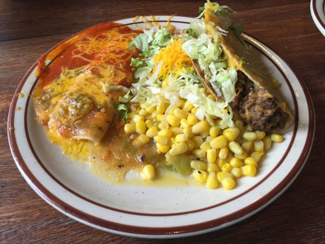 "The lunch special ""A"" with a cheese enchilada (smothered in Christmas), Mexican corn, and a taco"