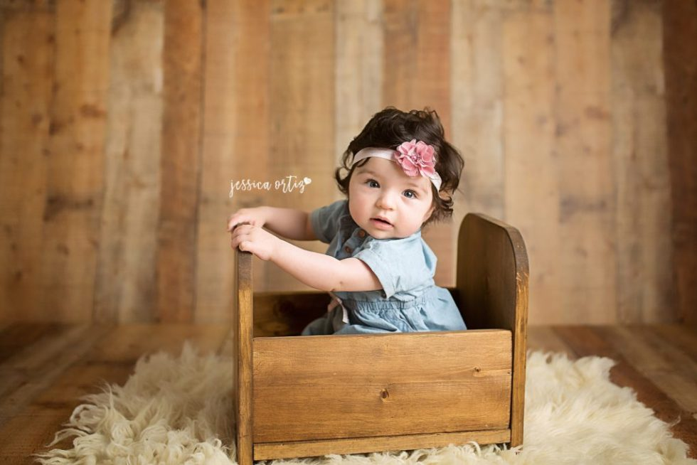ab9c03c263359 6 month old baby girl sitting in wooden bed for milestone session with  Jessica Ortiz photography ...