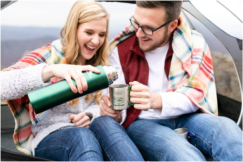 couple drinking coffee on top of a mountain, blue ridge parkway engagements, ravens roost candid couple photography, camping couple, hiking couple, adventurous couple