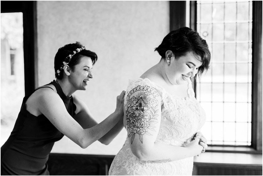 hermitage museum and gardens elopement, studio i do wedding dress, bride getting into wedding dress, candid wedding moment