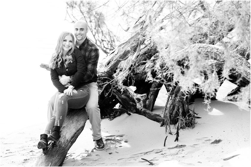Virginia state park engagement, first landing state park engagement photography, couple on the beach with driftwood, jessica ryan photography
