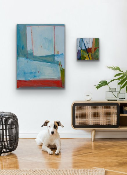 2 paintings and a dog in living room