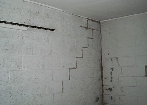 Foundation Wall Cracks - Stair-Step - This type of crack is a sign that your home is settling unevenly. This can result in a serious structural problem so it's important to call in a trusted foundation repair expert.