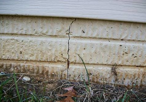 Foundation Wall Cracks - Vertical - If you have a concrete foundation, then hairline vertical cracks could be caused by shrinkage. As concrete cures it can crack. These cracks will typically form within the first year after the foundation was poured. If the crack is uneven or wider than 1/16-inch then it could be a sign that you have a structural problem.