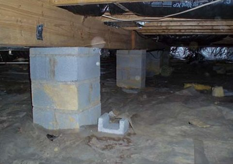 Cinder block support columns can and will break, like this picture shows. Sagging floors weren't the only problem for this home - their foundation was compromised. The solution - IntelliJack crawl space stabilizers which have a lifetime guarantee.