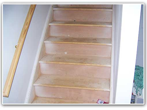 Musty basement smell from the mold growth on the organic material - the wooden stairs. Answer = solve the problem/s causing the mold growth. Keep reading.