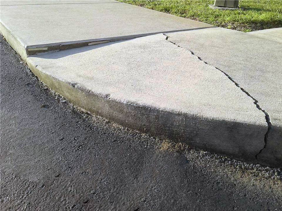 Cracked concrete before polyrenewal leveling