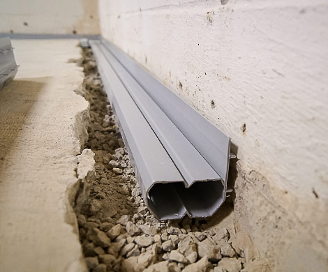 French drain in basement closeup