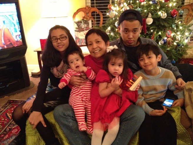 Mom, with 5 of her 9 grandchildren and 1 great grandchild last Christmas 2013.