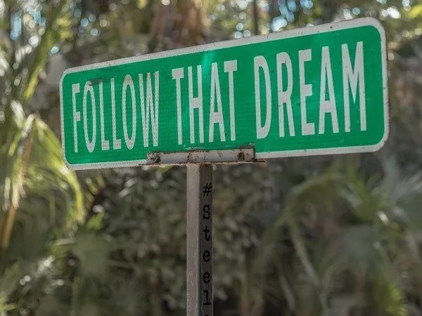 Famous follow that dream sign one of the top things to do in Tulum walking the beach strip.