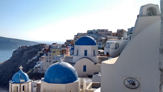 View of three blue domes in Santorini, Greece