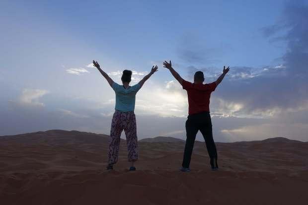 Hands up in the Sahara Desert