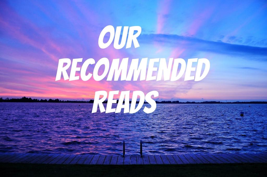 Purple sunset with the words Our Recommended Reads