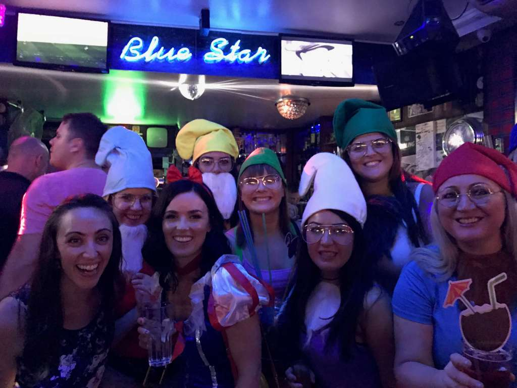 Woman dressed up as snow white and the seven dwarfs