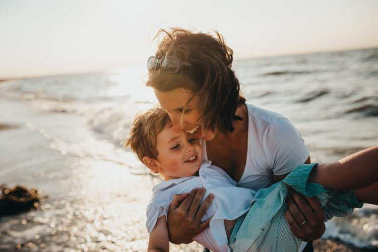 mother and child on a beach