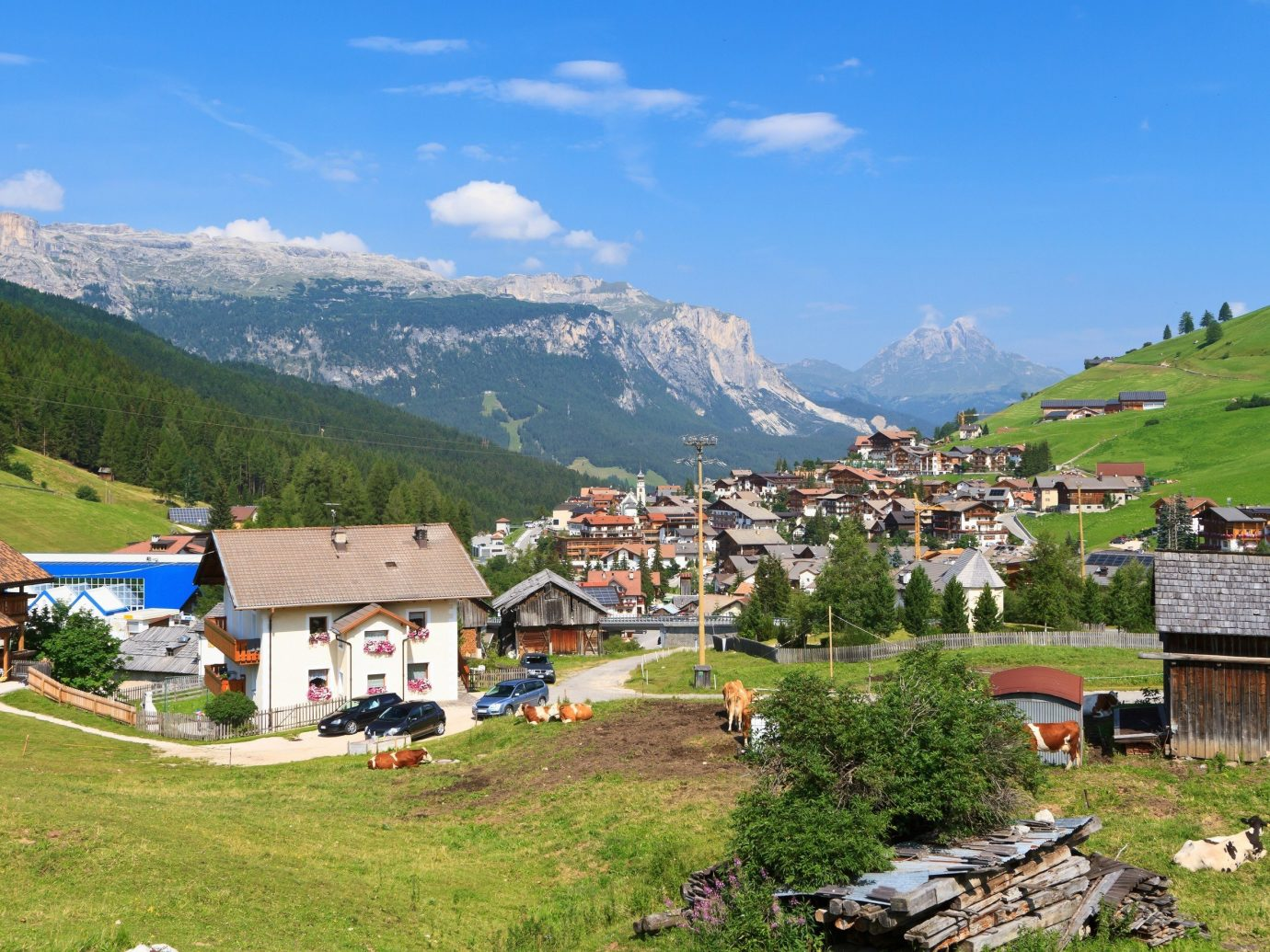 Secret Getaways Trip Ideas grass mountain outdoor sky mountainous landforms mountain range geographical feature Town Nature Village alps vacation tourism valley hill rural area landscape meadow plateau Adventure mountain pass old overlooking hillside highland