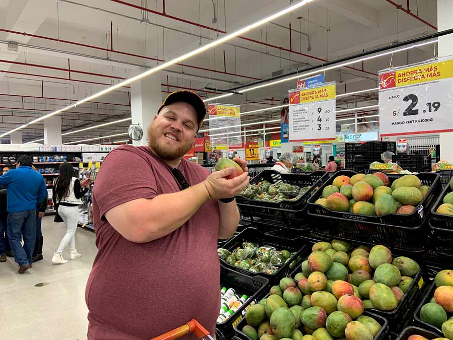 Jeff cradling a mango