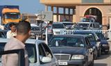 Libye: Les Algériens fuient les combats par Ras Jedir